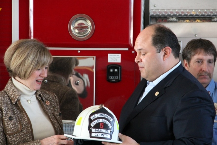 Firefighters Union President Tony Murray presents Congresswoman Brooks with a special fire helmet to be displayed at the Capitol.